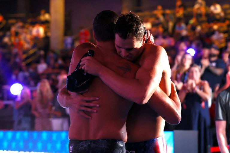 Ryan Lochte shares an embrace with 200m medley winner Michael Andrew at the US Olympic swimming trials, where Lochte's seventh-place finish ended his Tokyo Games bid