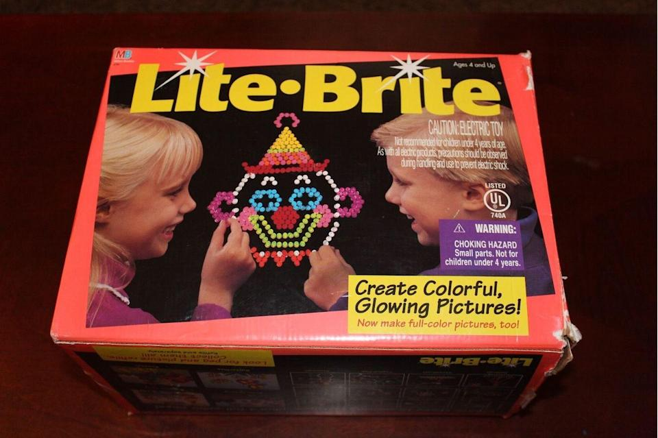 """<p>First marketed in 1967, this toy allowed children to create glowing art by fitting small, colored plastic pegs into an illuminated board. Full sets from the '70s and <a href=""""https://www.ebay.com/itm/Original-Lite-Brite-1993-Brand-NEW-FREE-SHIPPING/153305189951?hash=item23b1b38e3f:g:nb0AAOSwAFFb7cGn:rk:6:pf:0"""" rel=""""nofollow noopener"""" target=""""_blank"""" data-ylk=""""slk:'90s"""" class=""""link rapid-noclick-resp"""">'90s</a> go for <a href=""""https://www.ebay.com/itm/Vintage-Unused-NOS-1973-Hasbro-Lite-Brite-Rare-with-Box/152883468515?hash=item23989098e3:g:bs4AAOSwjIVabOP-:sc:USPSPriority!11102!US!-1:rk:7:pf:0"""" rel=""""nofollow noopener"""" target=""""_blank"""" data-ylk=""""slk:almost $300"""" class=""""link rapid-noclick-resp"""">almost $300</a> today.</p>"""