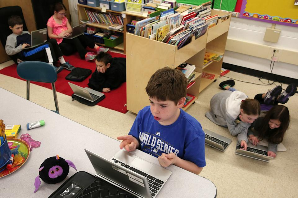 Seth Erdman, center, and his fellow students use Chromebooks while working on a lesson in a third grade class on Friday, Jan. 16, 2015, at Walden Elementary School in Deerfield, Ill. (Photo: Anthony Souffle/Chicago Tribune/TNS)