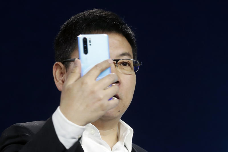 Huawei CEO Richard Yu displays the new Huawei P30 smartphone during a presentation, in Paris, Tuesday, March 26, 2019. (AP Photo/Thibault Camus)