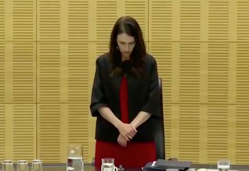 New Zealand's Prime Minister Ardern observes a minute of silence to mark one week since the deadly eruption of White Island