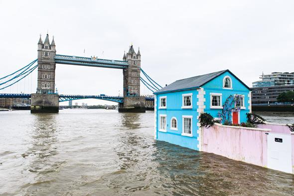 Monday 18th May 2015, London:  Airbnb�s latest London listing is pictured floating down the River Thames this morning.  This pic: The house with Tower Bridge in the background  The fully functioning Floating House will sail down the Thames to celebrate new rules that mean that Londoners � like the rest of the UK � can earn a 15 per cent pay rise* by sharing their homes through sites like Airbnb. Passing under Tower Bridge before gliding past the Shard on its maiden voyage, the House will meander along the river throughout the week until Saturday 22 May.  Copyright: � Mikael Buck / Airbnb +44 (0) 782 820 1042 http://www.mikaelbuck.com