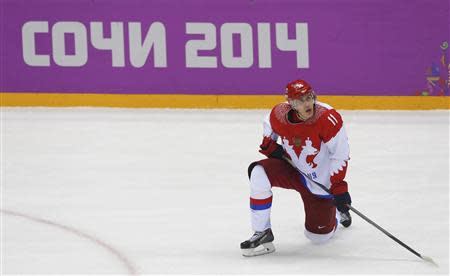 Russia's Yevgeni Malkin reacts after being defeated by Finland during their men's quarter-finals ice hockey game at the Sochi 2014 Winter Olympic Games February 19, 2014. REUTERS/Laszlo Balogh
