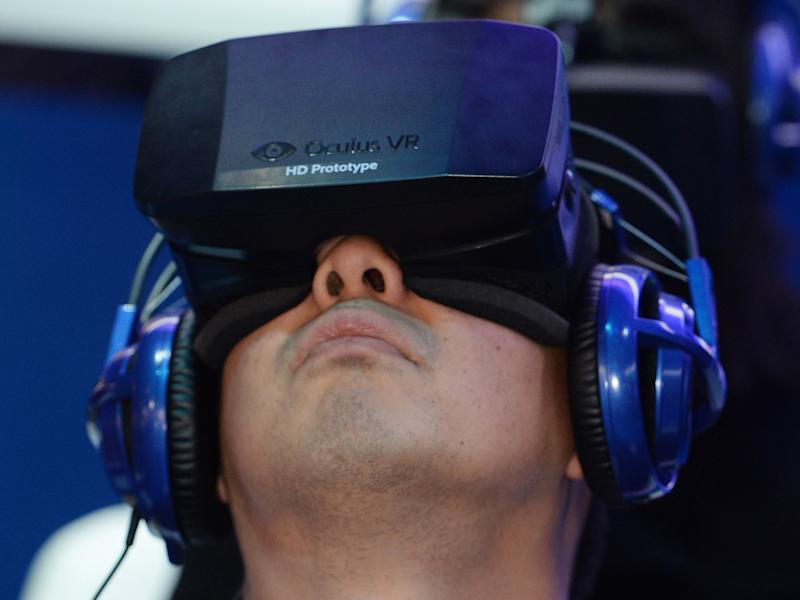 A man uses a prototype Oculus Rift at CES 2014: ROBYN BECK/AFP/Getty Images