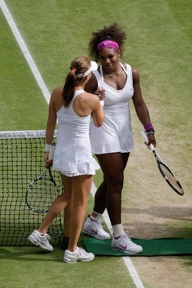 LONDON, ENGLAND - JULY 07: Serena Williams of the USA is congratulated by Agnieszka Radwanska of Poland after her Ladies? Singles final match on day twelve of the Wimbledon Lawn Tennis Championships at the All England Lawn Tennis and Croquet Club on July 7, 2012 in London, England. (Photo by Anja Niedringhaus/Pool/Getty Images)