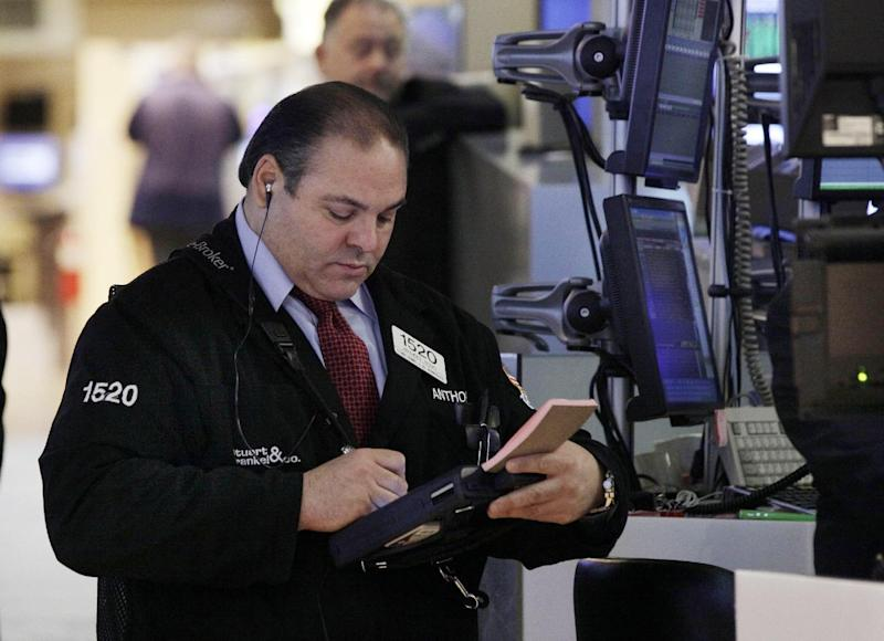 FILE - In this Tuesday, Dec. 11, 2012, file photo, trader Anthony Riccio works on the floor of the New York Stock Exchange. Expectations that the Federal Reserve will announce a new stimulus plan to help bring life to a lethargic U.S. economy boosted stock markets in Asia, where investors brushed off North Korea's latest test launch of a long-range rocket.  (AP Photo/Richard Drew, File)