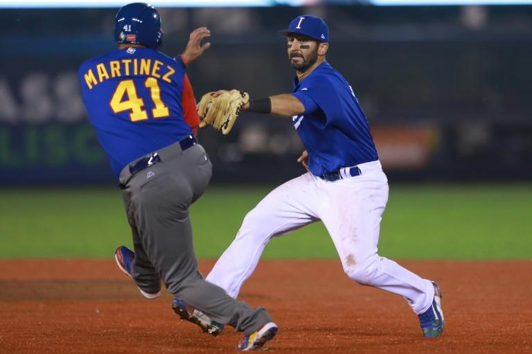 Daniel Descalso (R) of Italy tags out Victor Martinez of Venezuela in the top of the fifth inning during their World Baseball Classic Pool D game, at Panamericano Stadium in Zapopan, Mexico, on March 13, 2017