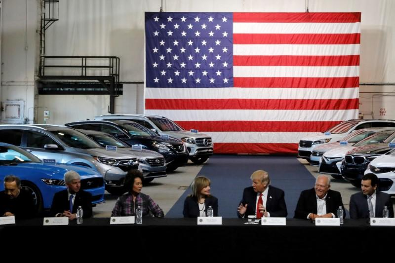 FILE PHOTO: Trump and Chao talk with auto industry leaders at the American Center for Mobility in Ypsilanti Township