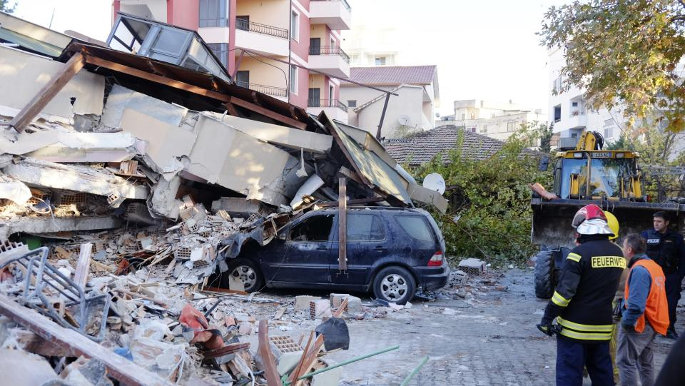 Rescue crews used excavators to search for survivors trapped in toppled apartment buildings after a powerful pre-dawn earthquake in Albania. (Photo: Hektor Pustina/AP)