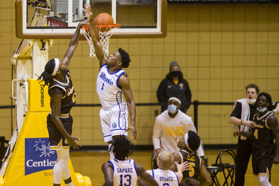 Valparaiso's Sheldon Edwards, left, dunks against Drake's JosephYesufu (1) during the second half of an NCAA college basketball game on Sunday, Feb. 7, 2021, in Valparaiso, Ind. (AP Photo/Robert Franklin)