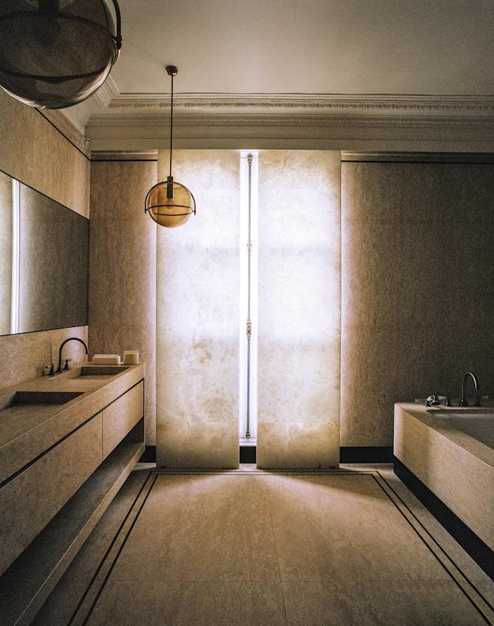 Alabaster panels cover the bath's window.