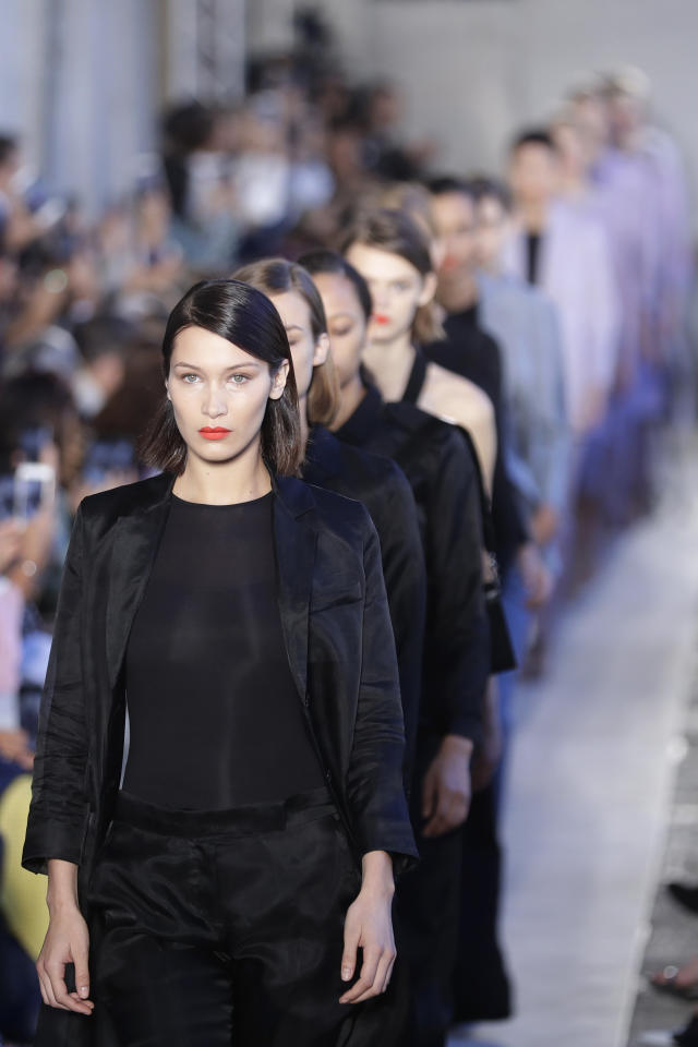 Model Bella Hadid leads other models as they wear creations as part of the Max Mara womens Fall/Winter 2018/19 fashion collection, presented in Milan, Italy, Thursday, Sept. 21, 2017. (AP Photo/Antonio Calanni)