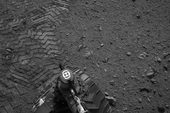 "Tracks from the Mars rover Curiosity's first test drive include the name of its maker, ""JPL"" spelled out in Morse code."