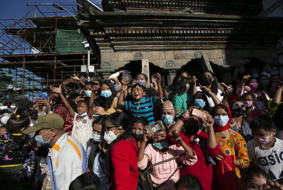 Nepalese devotees gather to watch the annual Indra Jatra festival in Kathmandu, Nepal, Sunday, Sept. 19, 2021. The feast of Indra Jatra marks the return of the festival season in the Himalayan nation two years after it was scaled down because the pandemic. (AP Photo/Niranjan Shrestha)