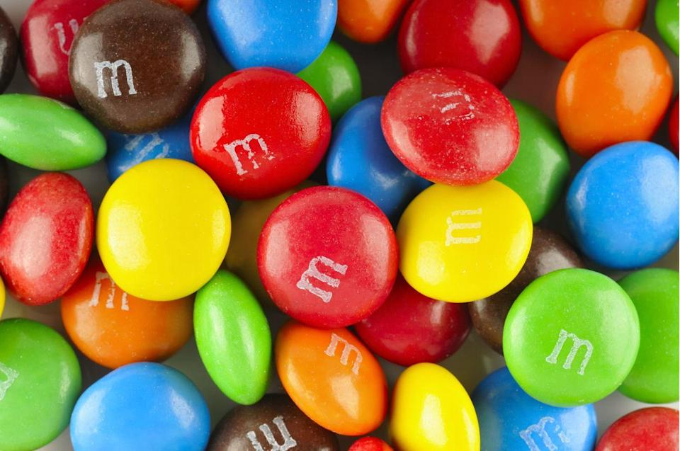 "<p>Forrest Mars (son of the Mars Company founder) first spotted the British confection Smarties during the Spanish Civil War and noticed the candy shell prevented the <a href=""https://www.goodhousekeeping.com/health/diet-nutrition/news/a44948/chocolate-brain-benefits/"" rel=""nofollow noopener"" target=""_blank"" data-ylk=""slk:chocolate"" class=""link rapid-noclick-resp"">chocolate</a> from <a href=""https://www.goodhousekeeping.com/food-recipes/cooking/tips/g2063/how-to-melt-chocolate/"" rel=""nofollow noopener"" target=""_blank"" data-ylk=""slk:melting"" class=""link rapid-noclick-resp"">melting</a>. He teamed up with Bruce Murrie (son of Hershey Chocolate's president) and the company later trademarked the ""Melts in Your Mouth, Not in Your Hand"" slogan.</p><p><strong>RELATED: </strong><a href=""https://www.goodhousekeeping.com/food-recipes/party-ideas/news/a25730/american-food-facts/"" rel=""nofollow noopener"" target=""_blank"" data-ylk=""slk:50 American Food Facts You Didn't Know"" class=""link rapid-noclick-resp"">50 American Food Facts You Didn't Know</a></p>"