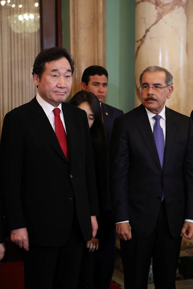 South Korea's Prime Minister Lee Nak-yeon stands with Dominican Republic President Danilo Medina at the national palace in Santo Domingo, March 15, 2018. REUTERS/Ricardo Rojas