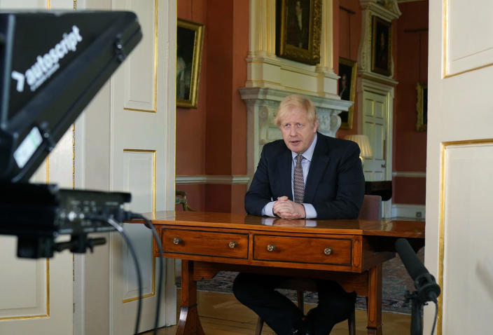 """In this photo issued by 10 Downing Street on Sunday, May 10, 2020, Britain's Prime Minister Boris Johnson delivers an address on lifting the country's lockdown amid the coronavirus pandemic.  Johnson announced a modest easing of the country's coronavirus lockdown and outlined his government's road map for further lifting restrictions in the coming months. In a televised address to the nation, Johnson said people in Britain who can't work from home, such as those in construction or manufacturing jobs, """"should be actively encouraged to go to work"""" this week. (Andrew Parsons/10 Downing Street via AP)"""