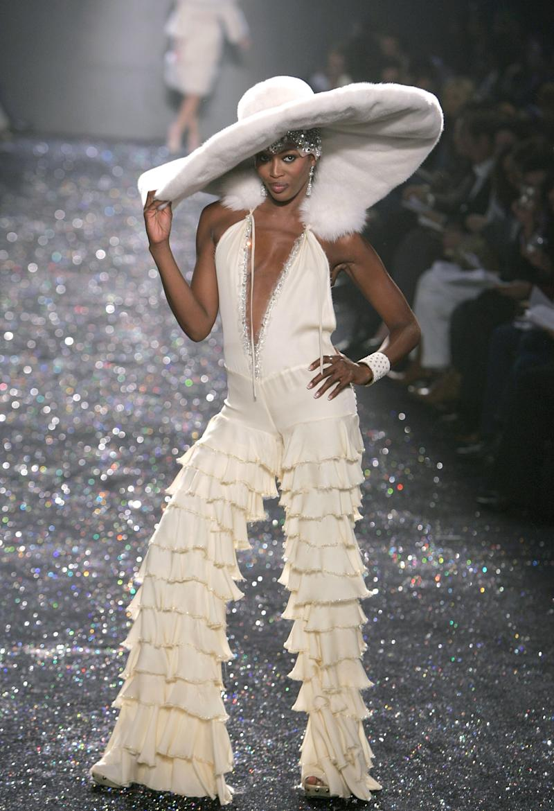 Naomi Campbell walks the runway of her crush (and fellow ageless icon) Jennifer Lopez's fall/winter 2005 show during New York Fashion Week in 2005. Photo courtesy of Getty Images.