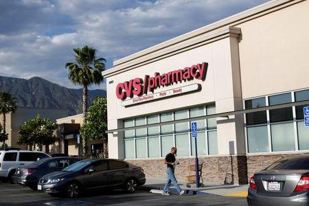 A person walks by a CVS Pharmacy store in Pasadena