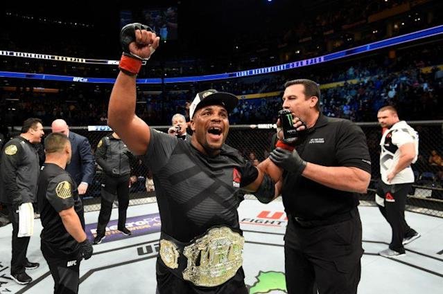 "Light heavyweight champion Daniel Cormier celebrates after submitting <a class=""link rapid-noclick-resp"" href=""/nfl/players/28097/"" data-ylk=""slk:Anthony Johnson"">Anthony Johnson</a> at UFC 210 Saturday in Buffalo, N.Y. (Getty Images)"
