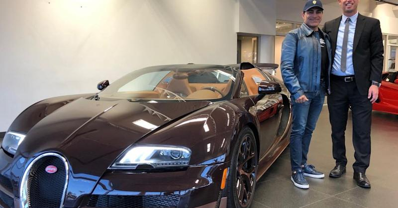 Khoshbin at dealership eyeing his Bugatti Rembrandt with Nick Jones, General Sales Manager of Bugatti Long Beach