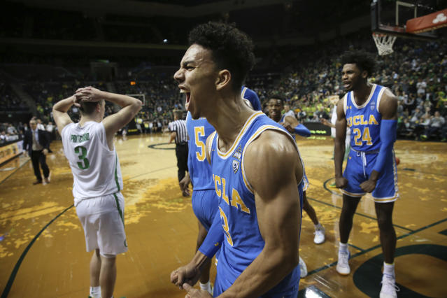 Oregon's Payton Pritchard, left, reacts as UCLA's Jules Bernard, center, and Jalen Hill, right, as they close the gap on the Ducks in the closing seconds of regulation of an NCAA college basketball game Thursday, Jan 10, 2019, in Eugene, Ore. (AP photo/Chris Pietsch)