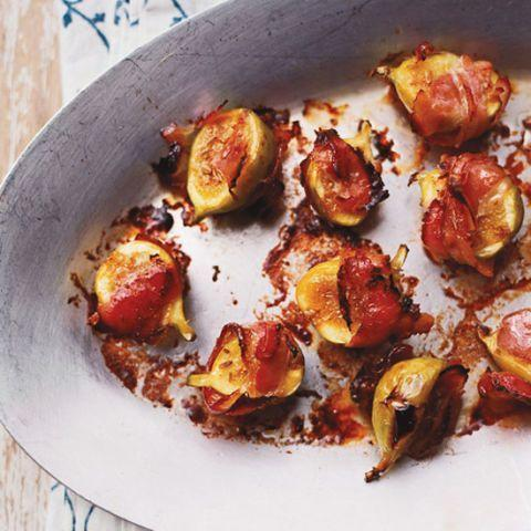 """<p>These grilled green figs sprinkled with fennel seeds and wrapped in pancetta are simply delicious. </p><p>Get the <a href=""""https://www.delish.com/uk/cooking/recipes/a33263737/grilled-green-figs-with-pancetta/"""" rel=""""nofollow noopener"""" target=""""_blank"""" data-ylk=""""slk:Grilled Green Figs with Pancetta"""" class=""""link rapid-noclick-resp"""">Grilled Green Figs with Pancetta</a> recipe. </p>"""