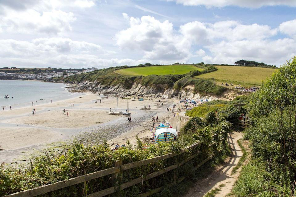"""<p>There are those who skip their sweets to prepare for a trip to the beach, and then there are those in-the-know who go to the beach for a quintessential Cornish feast. <u><a href=""""http://www.hiddenhut.co.uk"""" rel=""""nofollow noopener"""" target=""""_blank"""" data-ylk=""""slk:The Hidden Hut"""" class=""""link rapid-noclick-resp"""">The Hidden Hut </a></u>in Porthcurnick is a tiny, open-air cafe located on a National Trust coastal path serving up seafood, curry and the tastiest pasties in Cornwall. </p><p><strong>Don't Miss:</strong> Tickets for The Hidden Hut's famous dinnertime 'feasts' typically sell out within an hour of being posted online. The BYOB meals are enjoyed al fresco, with diners gathered in conversation around cosy fire pits.</p>"""