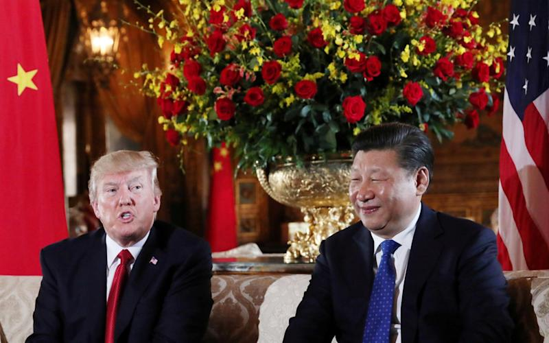 U.S. President Donald Trump welcomes Chinese President Xi Jinping at Mar-a-Lago state in Palm Beach, Florida - Credit: Reuters