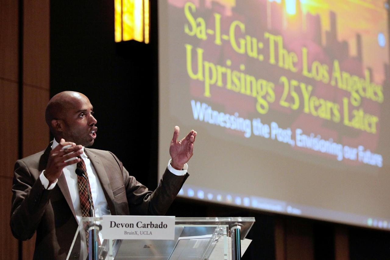 """Moderator Devon Carbado speaks during a panel discussion about the 25th anniversary of 1992 Los Angeles Riots, """"Sa-I-Gu: The Los Angeles Uprisings 25 Years Later"""" at UCLA in Los Angeles, California, U.S., April 28, 2017.    REUTERS/Hyungwon Kang"""