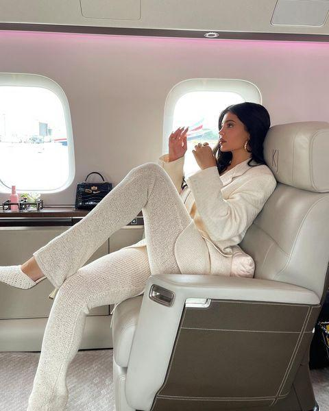 """<p>The mother-of-one showed us how she travels in style with her recent Instagram post of herself on a private jet captioned: 'it's business baby'.</p><p>Jenner posed in a cream suit by Magda Butrym with matching woven heels and lace-front top. She accessorised the outfit with an <a href=""""https://www.elle.com/uk/fashion/celebrity-style/a35516547/kylie-jenner-birkin-bag-birkinstocks/"""" rel=""""nofollow noopener"""" target=""""_blank"""" data-ylk=""""slk:Hermès Kelly bag"""" class=""""link rapid-noclick-resp"""">Hermès Kelly bag</a> and <a href=""""https://go.redirectingat.com?id=127X1599956&url=https%3A%2F%2Fwww.net-a-porter.com%2Fen-gb%2Fshop%2Fdesigner%2Fjennifer-fisher&sref=https%3A%2F%2Fwww.elle.com%2Fuk%2Ffashion%2Fcelebrity-style%2Farticles%2Fg28404%2Fkylie-jenners-style-file%2F"""" rel=""""nofollow noopener"""" target=""""_blank"""" data-ylk=""""slk:Jennifer Fisher gold hoop earrings"""" class=""""link rapid-noclick-resp"""">Jennifer Fisher gold hoop earrings</a>.</p><p><a class=""""link rapid-noclick-resp"""" href=""""https://www.magdabutrym.com/uk/product/ss21-blazer-03-cream"""" rel=""""nofollow noopener"""" target=""""_blank"""" data-ylk=""""slk:SHOP KYLIE'S JACKET HERE"""">SHOP KYLIE'S JACKET HERE</a></p><p><a href=""""https://www.instagram.com/p/CNnhRoSHX1P/"""" rel=""""nofollow noopener"""" target=""""_blank"""" data-ylk=""""slk:See the original post on Instagram"""" class=""""link rapid-noclick-resp"""">See the original post on Instagram</a></p>"""