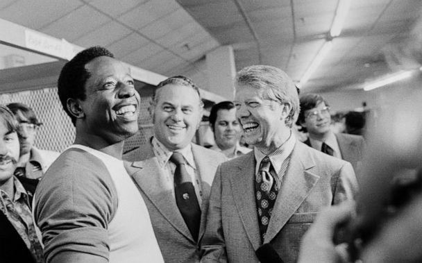 PHOTO: Governors Jimmy Carter, right, of Georgia and Sherman Tribbitt, center, of Delaware, draw a big laugh from Braves' slugger Hank Aaron as they visit him in the clubhouse after the Braves' rained out bout with the Dodgers, Sept. 27, 1973. (Bettmann Archive via Getty Images, FILE)