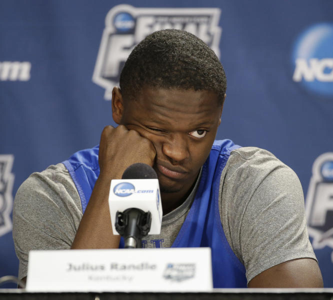 Kentucky forward Julius Randle answers a question during a news conference for the NCAA Final Four tournament college basketball championship game Sunday, April 6, 2014, in Arlington, Texas. Kentucky plays Connecticut in the championship game on Monday, April 7. 2014. (AP Photo/Tony Gutierrez)