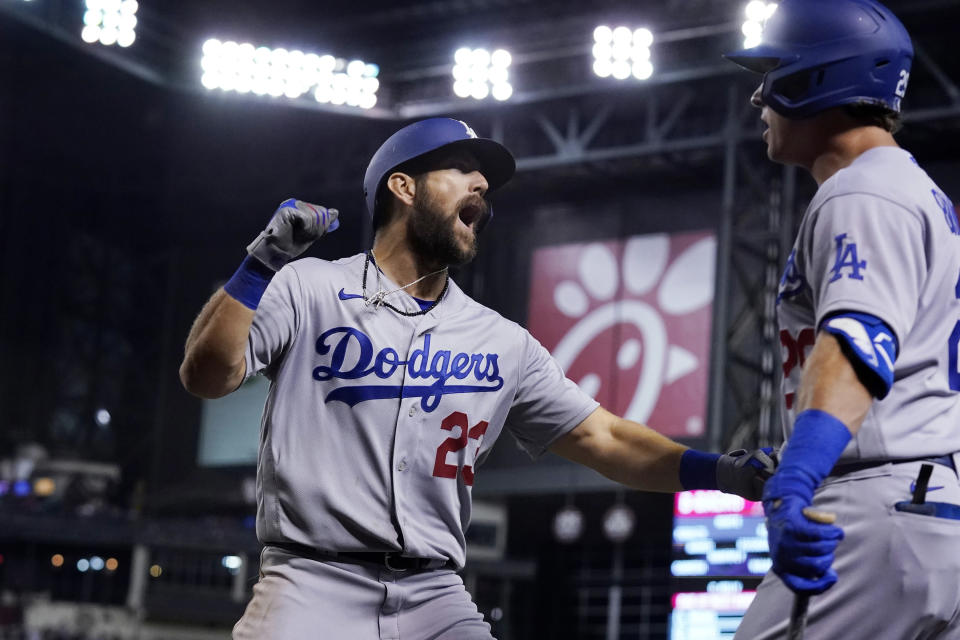 Los Angeles Dodgers' Steven Souza, left, celebrates his home run against the Arizona Diamondbacks with Andy Burns during the eighth inning of a baseball game Friday, June 18, 2021, in Phoenix. (AP Photo/Ross D. Franklin)