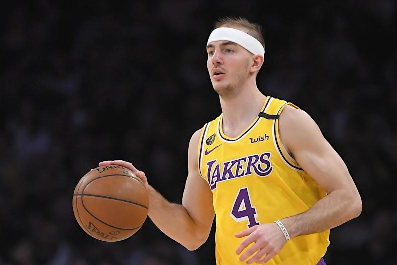 Los Angeles Lakers guard Alex Caruso dribbles during the second half of an NBA basketball game against the San Antonio Spurs Tuesday, Feb. 4, 2020, in Los Angeles. The Lakers won 129-102. (AP Photo/Mark J. Terrill)