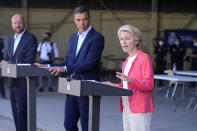EU Commission president Ursula von der Leyen, right, speaks alongside EU Council President Charles Michel, left, and Spain's Prime Minister Pedro Sanchez during a news conference at the Torrejon military airbase in Madrid, Spain, Saturday, Aug. 21, 2021. Top European Union officials visited a Spanish military airport being used as a hub to receive Afghans flown out of Kabul before they are distributed to other countries in the bloc. (AP Photo/Paul White)
