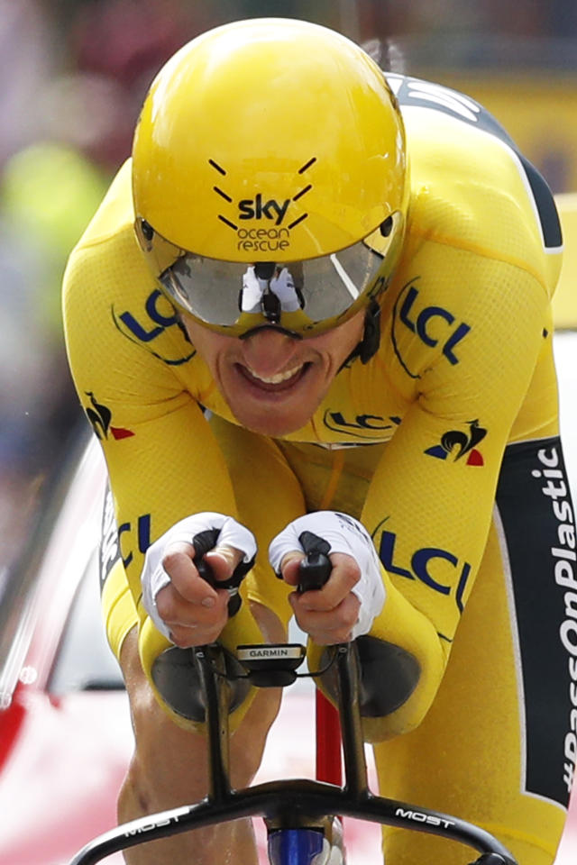 Britain's Geraint Thomas, wearing the overall leader's yellow jersey, strains during the twentieth stage of the Tour de France cycling race, an individual time trial over 31 kilometers (19.3 miles)with start in Saint-Pee-sur-Nivelle and finish in Espelette, France, Saturday July 28, 2018. (AP Photo/Christophe Ena )