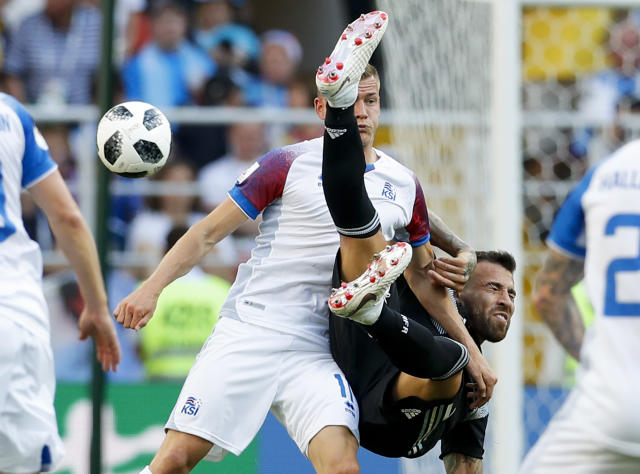 Iceland's Alfred Finnbogason, left, and Argentina's Nicolas Otamendi fight for the ball during the group D match between Argentina and Iceland at the 2018 soccer World Cup in the Spartak Stadium in Moscow, Russia, Saturday, June 16, 2018. (AP Photo/Antonio Calanni)