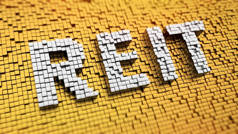 REIT acronym in white letters on top of a yellow mosaic pattern.