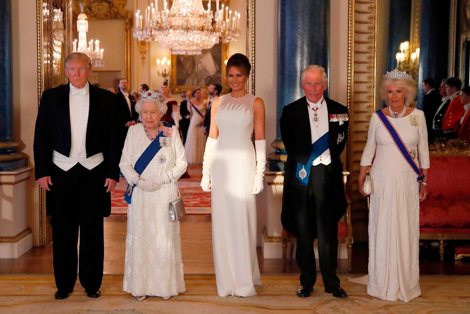 Britain's Queen Elizabeth II (2L), US President Donald Trump (L), US First Lady Melania Trump (C), Britain's Prince Charles, Prince of Wales (2R) and Britain's Camilla, Duchess of Cornwall pose for a photograph ahead of a State Banquet in the ballroom at Buckingham Palace in central London on June 3, 2019, on the first day of the US president and First Lady's three-day State Visit to the UK. - Britain rolled out the red carpet for US President Donald Trump on June 3 as he arrived in Britain for a state visit already overshadowed by his outspoken remarks on Brexit. (Photo by Alastair Grant / POOL / AFP)        (Photo credit should read ALASTAIR GRANT/AFP/Getty Images)