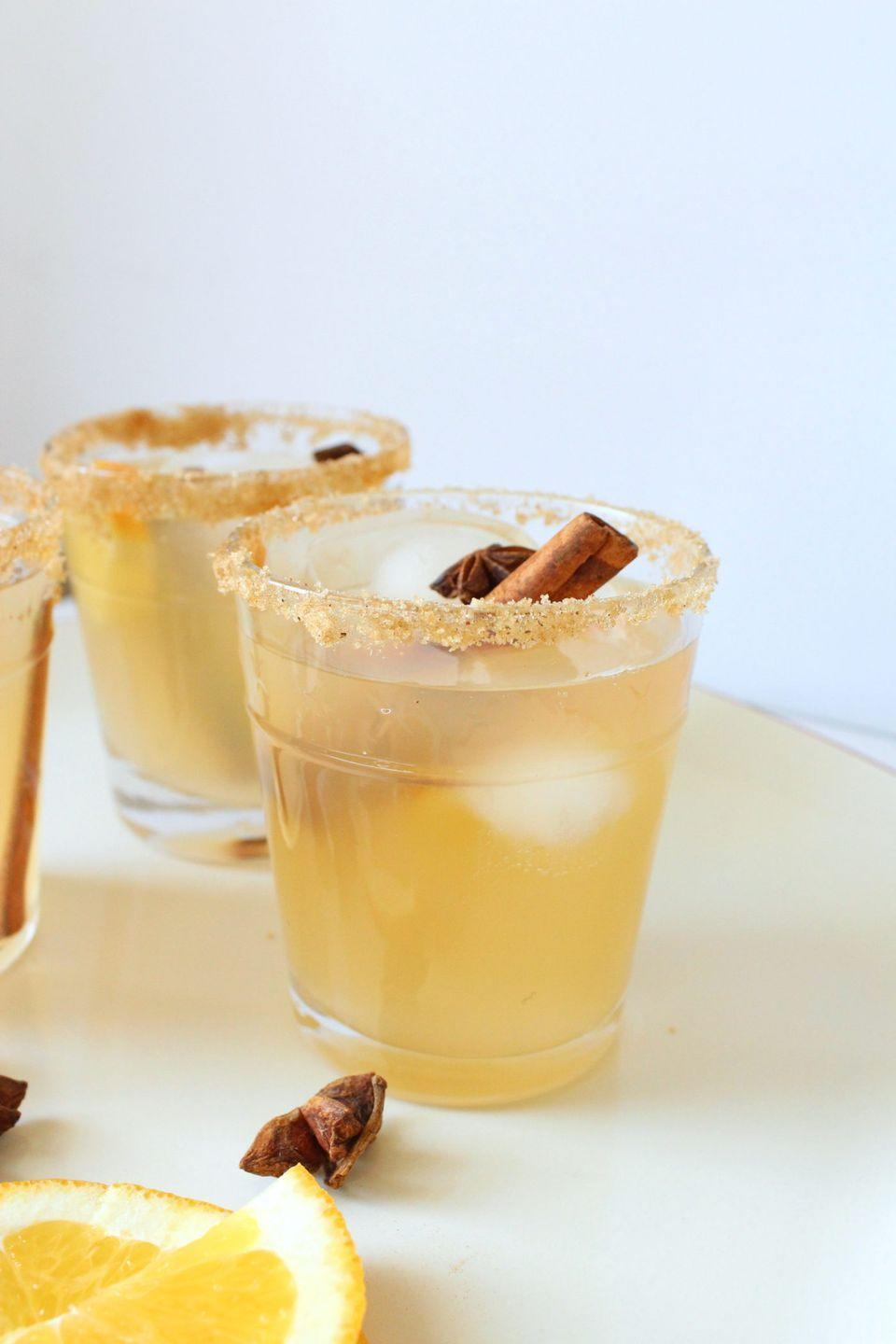 """<p>Looking to make a batch of margaritas perfect for fall? This batch of apple cider-infused sips will do!</p><p><strong>Get the recipe at <a href=""""http://eatdrinkfrolic.com/2018/12/apple-cider-margaritas.html"""" rel=""""nofollow noopener"""" target=""""_blank"""" data-ylk=""""slk:Eat Drink Frolic"""" class=""""link rapid-noclick-resp"""">Eat Drink Frolic</a>.</strong></p><p><a class=""""link rapid-noclick-resp"""" href=""""https://go.redirectingat.com?id=74968X1596630&url=https%3A%2F%2Fwww.walmart.com%2Fsearch%2F%3Fquery%3Dcinnamon%2Bsticks&sref=https%3A%2F%2Fwww.thepioneerwoman.com%2Ffood-cooking%2Fmeals-menus%2Fg33510531%2Ffall-cocktail-recipes%2F"""" rel=""""nofollow noopener"""" target=""""_blank"""" data-ylk=""""slk:SHOP CINNAMON STICKS"""">SHOP CINNAMON STICKS</a></p>"""
