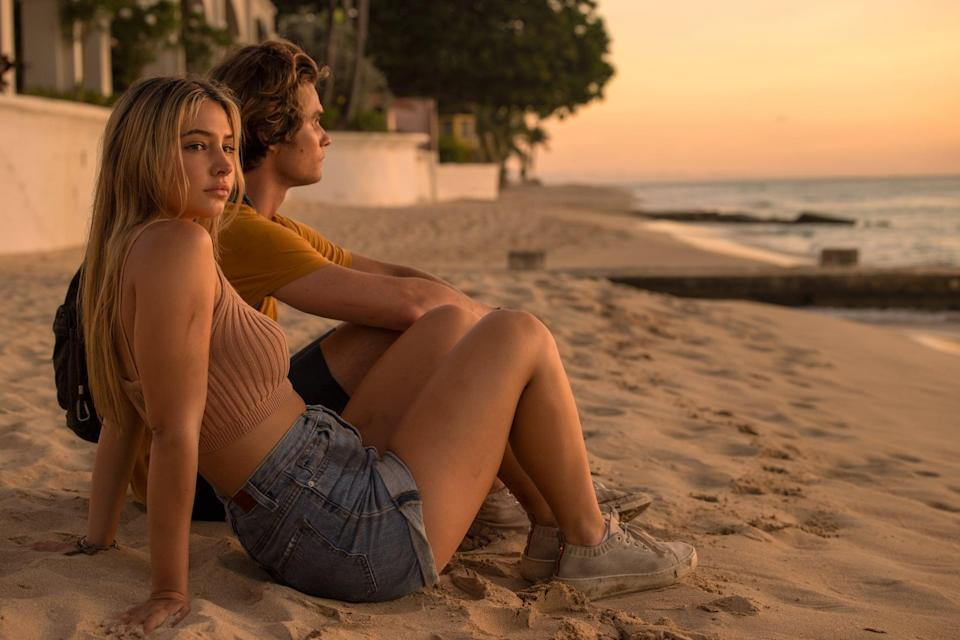 OUTER BANKS (L to R) MADELYN CLINE as SARAH CAMERON and CHASE STOKES as JOHN B in episode 201 of OUTER BANKS Cr. JACKSON LEE DAVIS/NETFLIX  2021