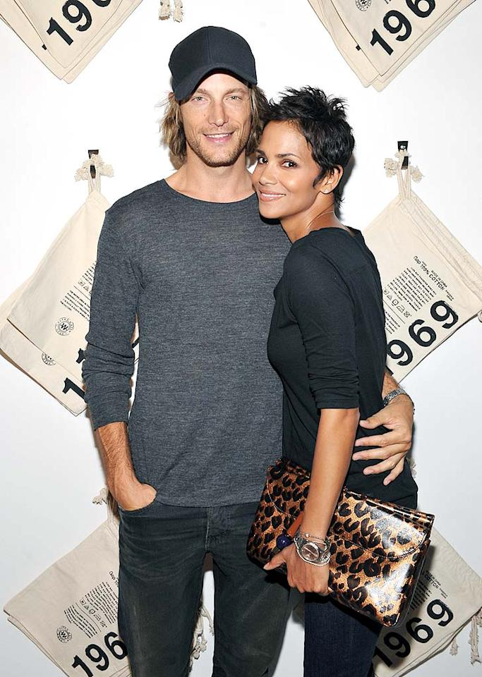 "Halle Berry cozied up to her gorgeous boyfriend, Gabriel Aubrey, at the launch party for Gap's new 1969 Jeans Shop on LA's trendy Robertson Boulevard. John Shearer/<a href=""http://www.gettyimages.com/"" target=""new"">GettyImages.com</a> - August 6, 2009"