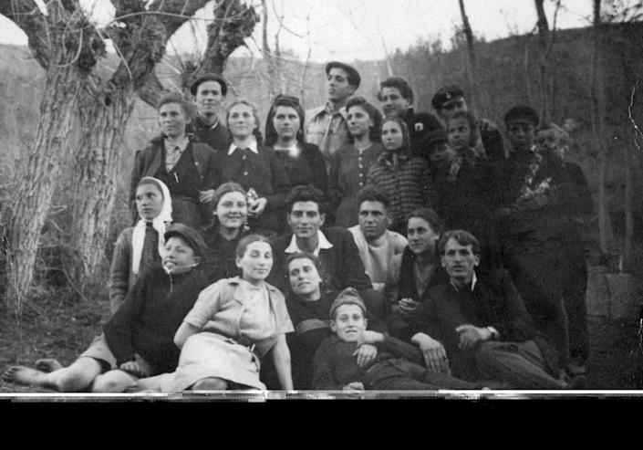 A black-and-white photo of a group of people posing together.