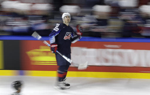 In this picture shot with a slow shutter speed Chris Kreider of the United States celebrates with his teammate scoring during the Ice Hockey World Championships bronze medal match between Canada and the United States at the Royal arena in Copenhagen, Denmark, Sunday, May 20, 2018. (AP Photo/Petr David Josek)