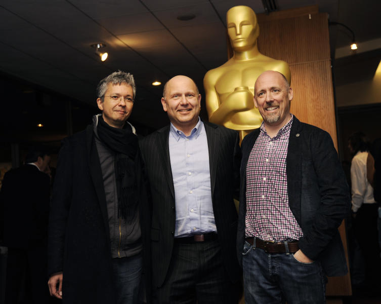 """Pierre Coffin, left, and Chris Renaud, right, co-directors of the Oscar-nominated feature film """"Despicable Me 2,"""" pose with producer Chris Meledandri at a reception featuring the Oscar nominees in the Animated Feature Film category on Friday, Feb. 28, 2014, in Beverly Hills, Calif. The 86th Oscars ceremony will be held on Sunday at the Dolby Theatre in Los Angeles. (Photo by Chris Pizzello/Invision/AP)"""