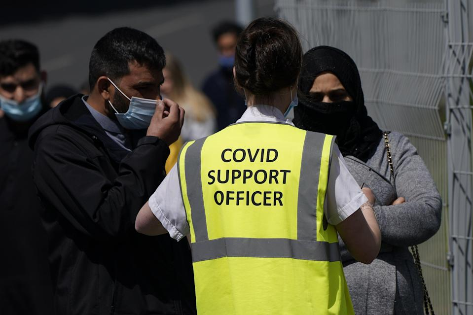 <p>A coronavirus support officer is seen in Bolton, a hotspot for the Indian coronavirus variant</p> (PA Wire)