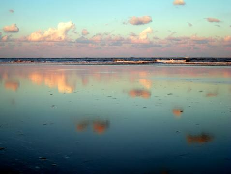 "<p>A barrier island with five miles of powdery sands that host five smaller beaches, <a href=""https://visittybee.com/"" rel=""nofollow noopener"" target=""_blank"" data-ylk=""slk:Tybee Island"" class=""link rapid-noclick-resp"">Tybee Island</a> is called ""Savannah's Beach"" for its easy access to the thriving city just 30 minutes away. Those wide sands are great for fat-tire cruising in addition to strolling, and warm waters make for fantastic swimming nearly year-round.</p>"