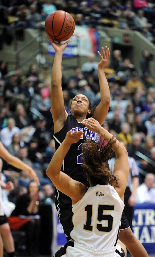 Holy Cross' Brisje Malone takes a shot at the basket as Army's Krishawn Tillett (15) defends during the first half of an NCAA college basketball game against Holy Cross in the Patriot League Championship at Christi Arena Saturday, March 15, 2014, at West Point, N.Y. (AP Photo/Karl Rabe)