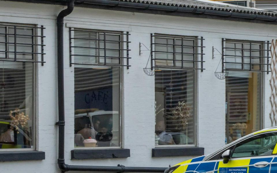 Police suspected to be dining inside The Chef House Kitchen Cafe, Greenwhich - Brian Jennings/SWNS